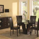 4 chairs round table rug cabinet lamp pic