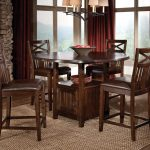4 chairs round table wood rug lamp curtains