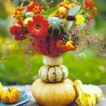 A bunch of flower with pumpkins as the pot designed by Country Garden Magazine