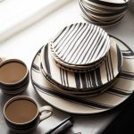A group of dishware including plates cups and bowls in strips pattern