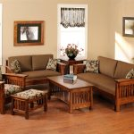 A set of wood chairs with cushions and leaves pattern pillows glass windows with upper curtains