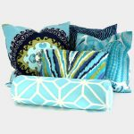 Beautiful blue bolster pillow and dominant blue throw pillows