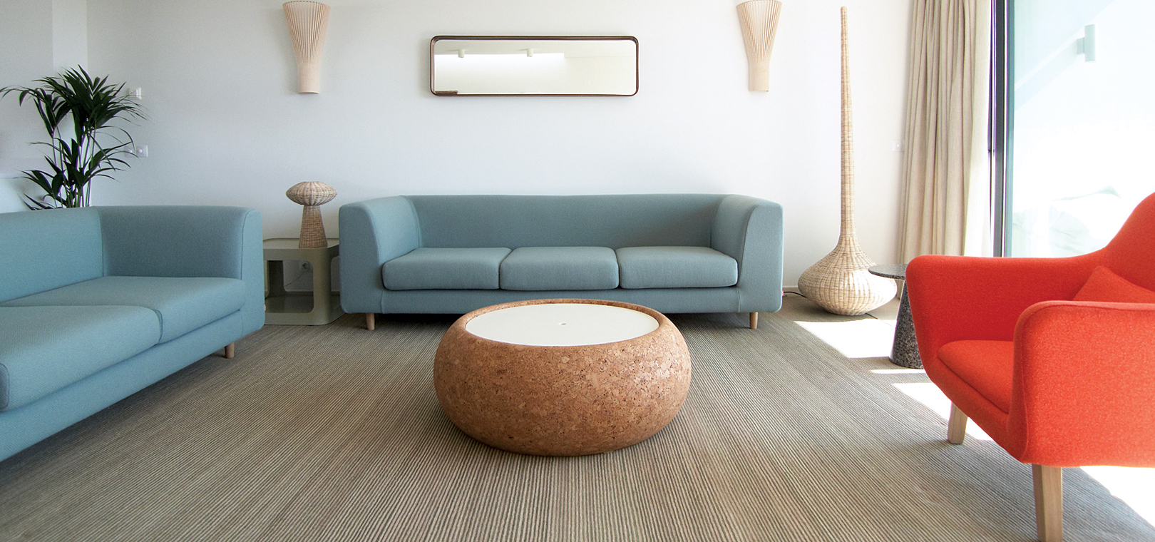 Beautiful blue sofas bright red arm chair unique round table in modern style