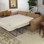Bed Sofa Idea In Cream With White Mattress An Area Rug With Floral Pattern A Classic Wooden Side Table With A Table Lamp