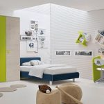 Dark blue bed with white bedding white textured wall idea green desk with white chair unique bookshelves mounted on wall green and light grey clothes closet design
