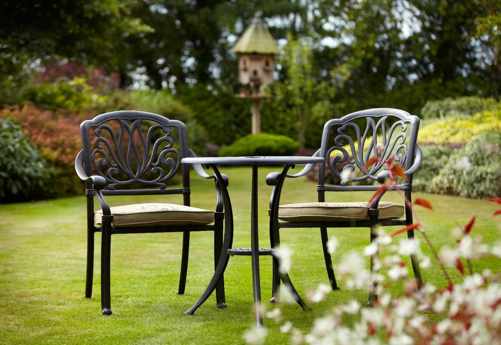 Elegant Black Outdoor Armchairs With Cushions Small Round Metal Table In Stain