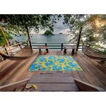 Fab Habitat flowery blue yellow recycled plastic outdoor rugs wooden outdoor furnitures hanging hammocks wooden open deck beautiful ocean view green trees