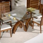Frameless glass dining table with  modern rustic wood dining chairs white linen rug idea for dining room