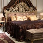 French empire bed bench style luxurious elegant bedroom soft peach cushions soft peach table lamps glossy dark brown bedsheet