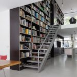 Giant bookshelves integrated with stairs