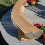 Large curved log bench for outdoor