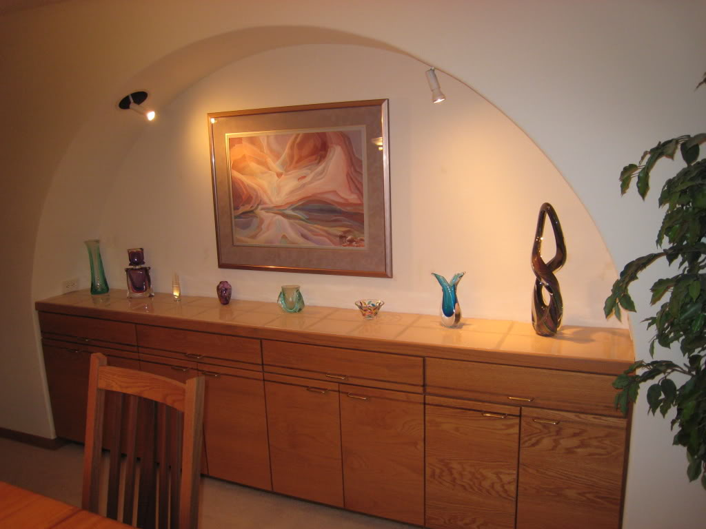 Larger Minimalist Wooden Cabinet System For Dining Room With Some Decorative Pieces On Top An Abstract