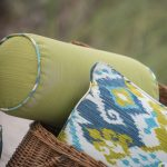 Light Green Bolster Pillow And A Throw Pillow In Randomly Colorful Patterns