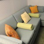 Light green bolster pillows some throw pillows light grey sofa
