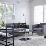 Light grey shag rug idea by IKEA for living room a set of grey sofa with pillow an oval coffee table with single metal leg a shelving unit for displaying books and some decorative items