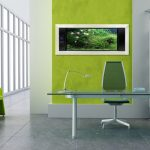 Light grey wall paint a wall area with green wall paint modern office desk movable office chair modern document rack with white single drawer underneath two green arm chairs