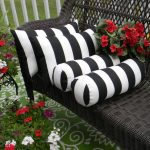 Monochromotic bolster pillows and throw pillows for black stained rattan chair