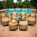 Natural tone rattan furniture with brown cushions and pillows a rattan table with glass top
