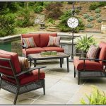 Patio armchairs with red cushions and decorative pillows free standing decorative clock with direction