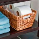 Rattan box as rolled tissues storage a pile of folded linens