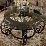 Round glass top table no frame dark coated iron base
