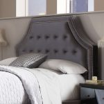 Semi classic headboard design with white line as decoration cozy white bedding white pillows white textured bedcover