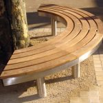 Simple curved wooden bench for patio
