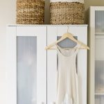 Storage rattan boxes on top of small closet storage