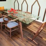 Transparent Glass Narrow Dining Table Wood Dining Chairs Wood Planks Flooring Idea