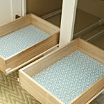 Two drawers of under bathroom sink storage system