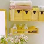 Wall cabinet system with a pile of towels and bathing supplies floating shelf for organzing the bottled supplies