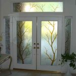 White elegant door with tree pattern stain glass panel and sidelights