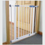 White metal safety gate installed in door frame