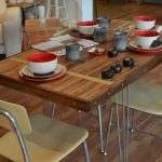 Wood planks dining table in minimalist style minimalist dining chairs some sets of bowls and flat plates