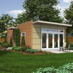 adorable creamy house plan for small house with glass door and concrete front porch with seating and side garden
