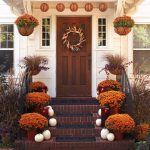 adorable entrance outdoor thanksgiving decoration idea with fall flower on staircase before wooden door with wreath