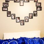 adorable heart shaped picture frame target design on cream wall above white headboard with blue pillows