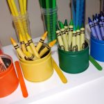 adorable modern vibran colored pencil holder design in orange yellow green and blue tone with modern pencils