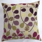 adorable purple accent pillow design with tropical pattern in black green and purple in square shape