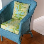 adorable rattan sofa design with painting fabric furniture of soft green bolster and cushion on hardwood floor