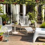 adorable vintage ikea lawn furniture design with wire net chairs and round white table beneath pergola with climbing plants