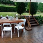 adorable white chairs and wooden dining table on wooden deck with stairs and topiary for best ikea lawn furniture