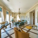 Asiant Style Penthouse In Atlanta With Diamond Patterned Floor And Patterned Couch And Blue Glass Paint Wall And Great Molding And Yellow Chair