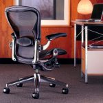 Awesome Glossy Black Herman Miller Aeron Chair Design With Firm Style And Stainless Frame Before Desk With Elegant Table Lamp