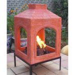 awesome reddish brick patterned chiminea fire pit design with black metal legs on patio with garden