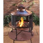 awesome vintage copper chiminea fire pit idea in round shape with unique cover and four metal legs and round base and paved patio and brick wall and garden