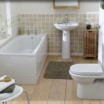 bath tub plant toilet rug chair floor bamboo sink mirror white