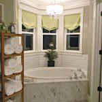 bath tub shelf towel lamp curtains sink