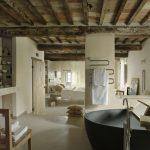 bathroom tub chair towel sink bed beams