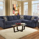 beautiful blue sectional sofa sleepers wooden floor living room with white fur rug abstract wall painting round table